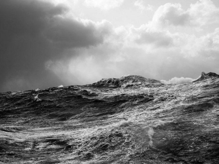 dark rough sea black and white image
