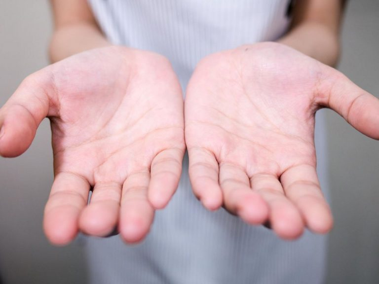 Left hand and right hand palms facing upwards